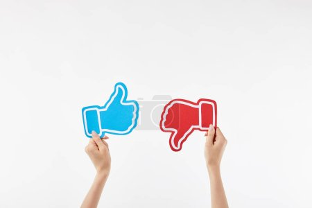 Photo for Cropped view of woman with blue thumb up and red thumb down symbols in hands isolated on white - Royalty Free Image