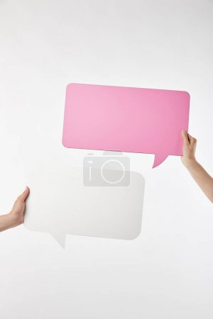 Photo for Cropped view of two women with speech bubbles in hands isolated on white - Royalty Free Image