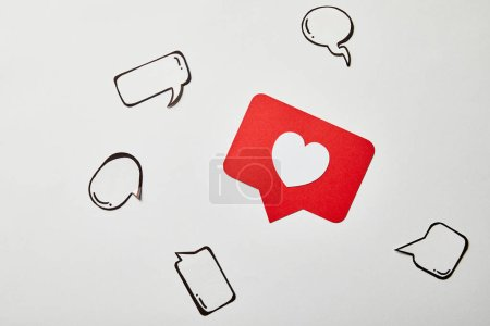 Photo for Red like sign card with thought and speech bubbles on white surface - Royalty Free Image