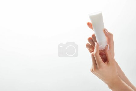 Photo for Cropped view of woman hands with cosmetic cream tube isolated on white - Royalty Free Image