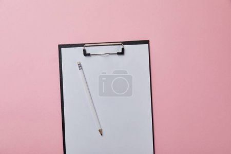 pencil on folder with empty paper isolated on pink