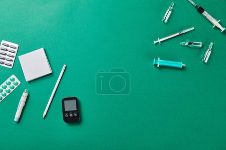 Photo for Various medical supplies with sticky notes and pencil on green bakground - Royalty Free Image