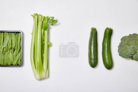 Photo for Top view of green fresh vegetables on white background - Royalty Free Image