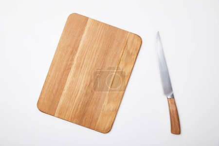 Photo for Top view of empty wooden chopping board and knife on white background - Royalty Free Image