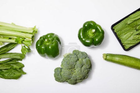 top view of green organic vegetables on white background
