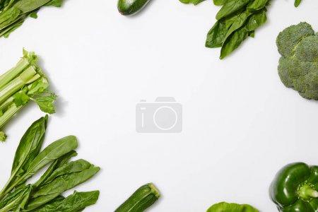 Foto de Top view of green nutritious vegetables on white background with copy space - Imagen libre de derechos