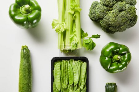 Photo for Flat lay with green delicious organic vegetables on white background - Royalty Free Image