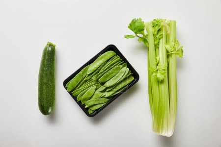 Foto de Top view of green organic vegetables on white background - Imagen libre de derechos