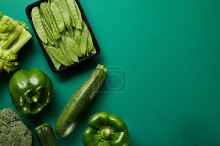 Photo for Top view of green fresh vegetables on green background - Royalty Free Image
