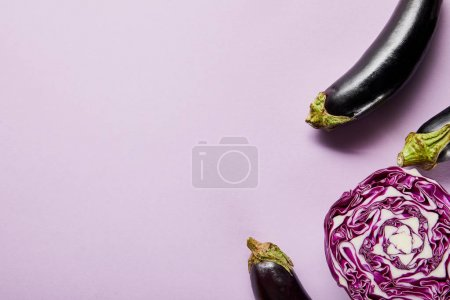 Photo for Top view of ripe eggplants and red cabbage on violet background with copy space - Royalty Free Image