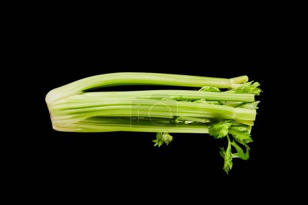 top view of fresh organic green leek isolated on black