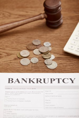 Photo for Bankruptcy form, gavel and coins on brown wooden table - Royalty Free Image