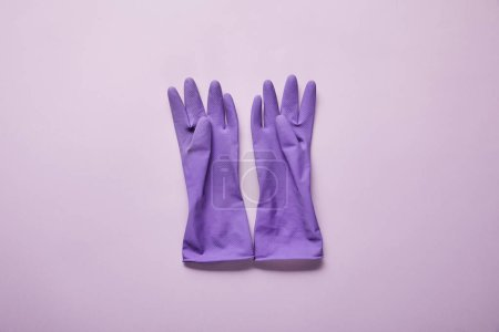 Photo for Top view of bright and colorful rubber gloves on purple background - Royalty Free Image