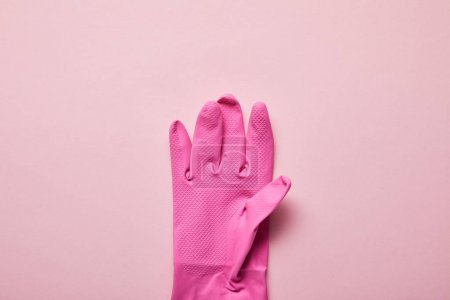 Photo for Top view of bright and colorful rubber glove on pink background - Royalty Free Image