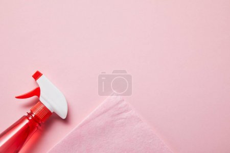 Photo for Top view of pink rag and bottle with spray on pink background - Royalty Free Image