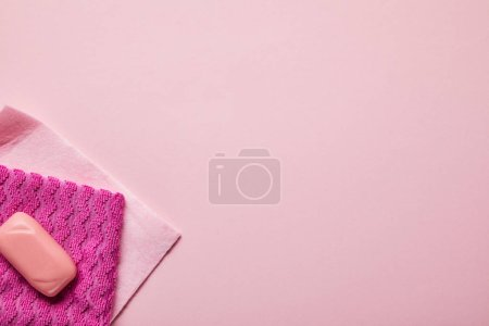 Photo for Top view of pink rags and soap on pink background - Royalty Free Image