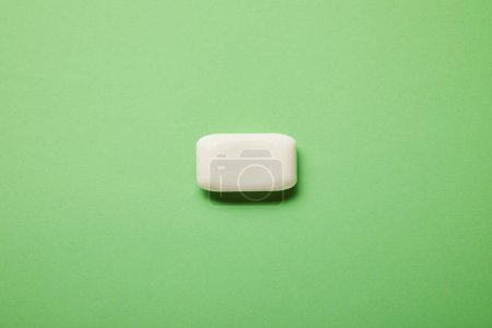 Photo for Top view of white soap on green background with copy space - Royalty Free Image