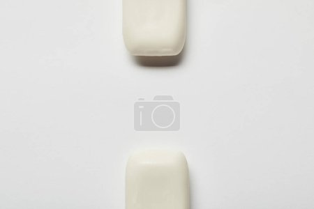 Photo for Top view of white soaps on grey background with copy space - Royalty Free Image