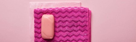 Photo for Top view of pink rags and bright soap on pink background - Royalty Free Image