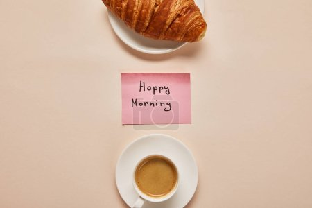 Photo for Flat lay with coffee, croissant and sticky note with happy morning lettering on beige background - Royalty Free Image