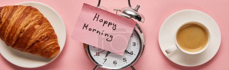 Photo for Top view of alarm clock with happy morning lettering on sticky note near coffee and croissant on pink background, panoramic shot - Royalty Free Image