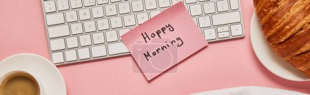 Photo for Top view of computer keyboard and pink sticky note with happy morning lettering near croissant and coffee on pink background, panoramic shot - Royalty Free Image