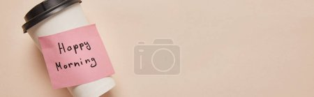 Photo for Top view of coffee to go and sticky note with happy morning lettering on beige background, panoramic shot - Royalty Free Image