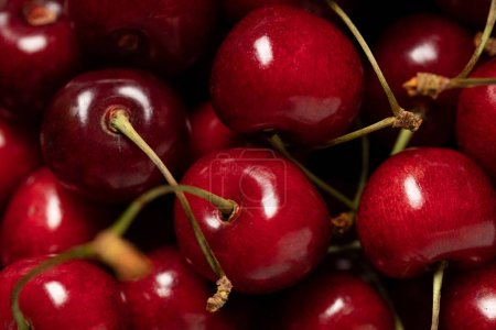 close up view of red delicious shiny cherries