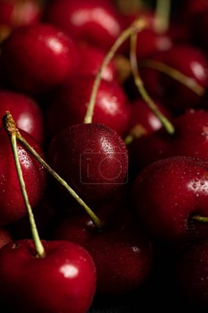 Photo for Close up view of red tasty and ripe cherries with water drops - Royalty Free Image