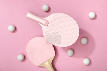 Photo for Top view of white table tennis balls and rackets on pink background - Royalty Free Image