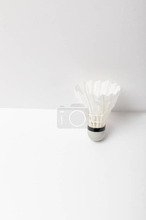 white light badminton shuttlecock on white background with copy space
