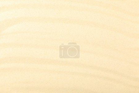 top view of beach with yellow textured sand and copy space