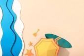 "Постер, картина, фотообои ""top view of paper beach with yellow umbrella, surfboard and starfishes on sand """