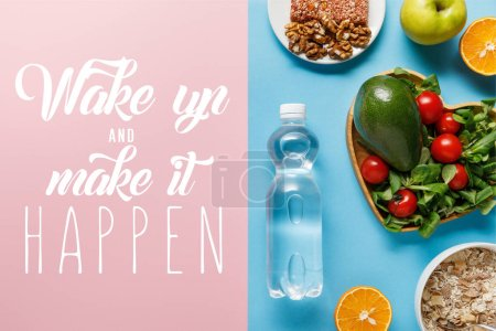 Photo for Top view of fresh fruits, crispbread and breakfast cereal on blue and pink background with wake up and make it happen lettering - Royalty Free Image