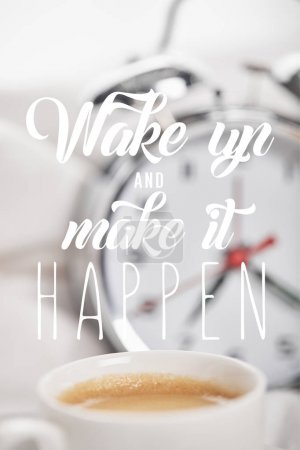 Photo for Selective focus of coffee in white cup with silver alarm clock in bed on background with wake up and make it happen - Royalty Free Image