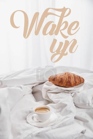 Photo for Fresh croissant on plate near coffee in white cup on saucer in bed with wake up illustration - Royalty Free Image