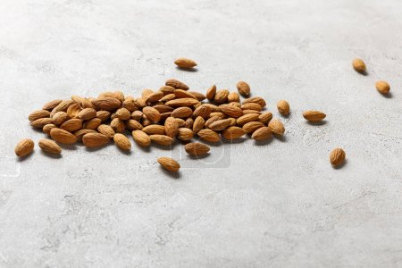 Photo for Fresh delicious almonds on grey textured surface, ketogenic diet menu - Royalty Free Image