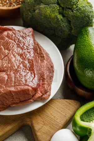 Photo for Close up view of raw meat near egg and avocado, , ketogenic diet menu - Royalty Free Image