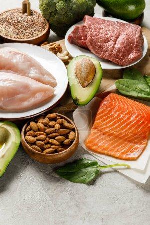 fresh raw ketogenic diet ingredients on grey background