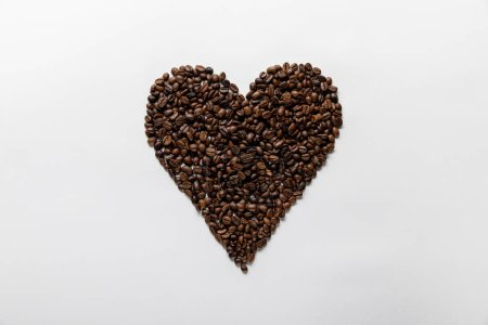 Photo for Top view of  heart made of fresh coffee grains on white background - Royalty Free Image