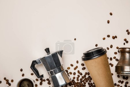 Photo for Top view of cezve, coffee pot, paper cup and  coffee grains on beige background - Royalty Free Image