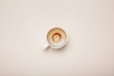 Photo for Top view of coffee cup with foam on beige background - Royalty Free Image
