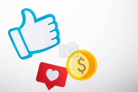 colorful paper icons with coin, heart and thumb up on white background
