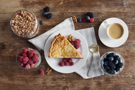 Photo for Top view of served breakfast with piece of pie, raspberries, oat flakes and cup of coffee - Royalty Free Image