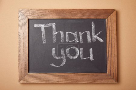 Photo for Chalkboard with thank you lettering on beige background - Royalty Free Image