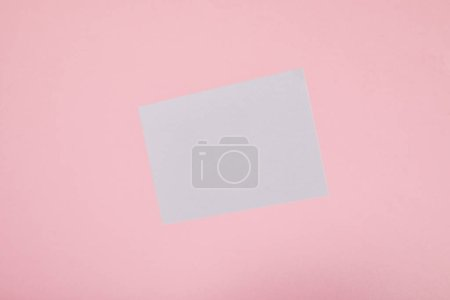 Photo for Top view of blank white card on pink background - Royalty Free Image