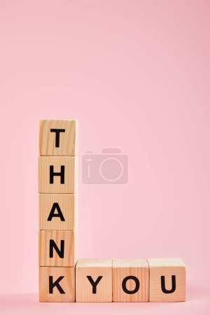 Photo for Wooden cubes with thank you lettering on pink background with copy space - Royalty Free Image