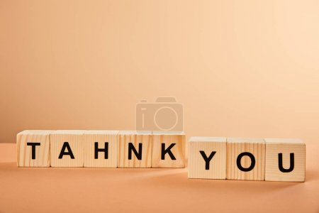 Photo for Wooden cubes with thank you lettering on table isolated on beige - Royalty Free Image