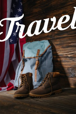 Photo for Trekking boots, backpack and american flag on wooden surface with travel illustration - Royalty Free Image