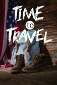 """Постер, картина, фотообои """"trekking boots, backpack and american flag on wooden surface with time to travel illustration"""""""